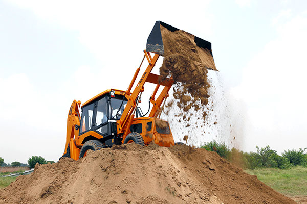ACE AX 130 Backhoe Loader in Action